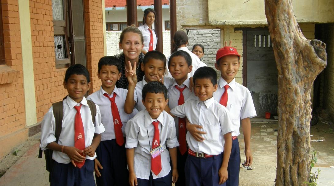 A group photo of a Projects Abroad volunteer with her students at her volunteer teaching placement in Nepal